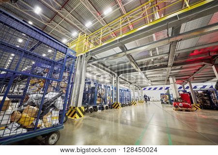 RUSSIA, MOSCOW - DEC 16, 2014: Employees work in storage of automated sorting center in Vnukovo. Moscow Automated sorting center - the largest in Eastern Europe.