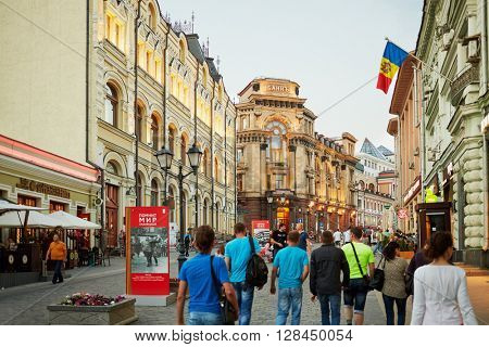RUSSIA, MOSCOW - JUN 22, 2015: People walk along Kuznetsky Most street. Kuznetsky Most one of the oldest streets in Moscow.