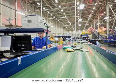 RUSSIA, MOSCOW - DEC 16, 2014: Postal workers of automated sorting center in Vnukovo. Moscow Automated sorting center - the largest in Eastern Europe.