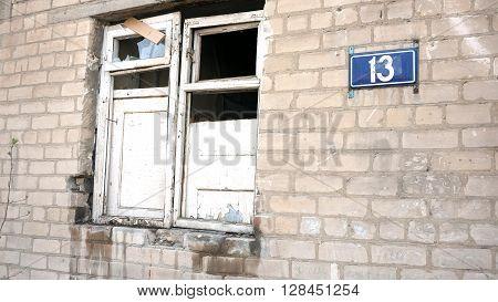 House number 13 destroyed. Broken window. Unlucky number.