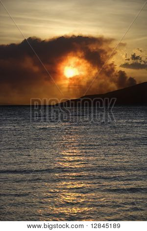 Dark clouds at sunset over water on Maui, Hawaii.