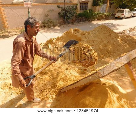 Refining Sand With Shovel Is a Very Tough Job.