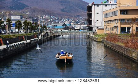 People Sightseeing Otaru Canal By Boat