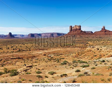 Scenic desert landscape with mountains and landforms.