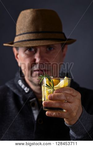 Man With A Glass Of Lemon Drink