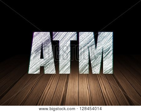 Currency concept: Glowing text ATM in grunge dark room with Wooden Floor, black background