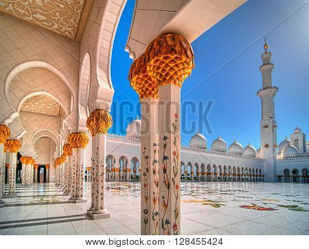 ABU DHABI, UAE - APR 9, 2013: Amazing sunset view at Sheikh Zayed Grand Mosque, Abu Dhabi, United Arab Emirates