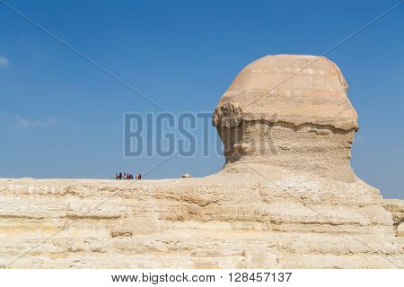 Tourists on the back of the Great Sphinx of Giza, Egypt.