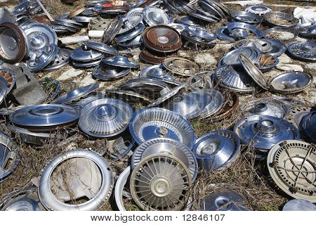 Old metal hubcaps strewn across the ground.