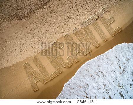 Alicante written on the beach