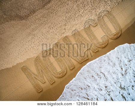 Monaco written on the beach