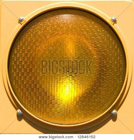 Closeup of yellow traffic stoplight.