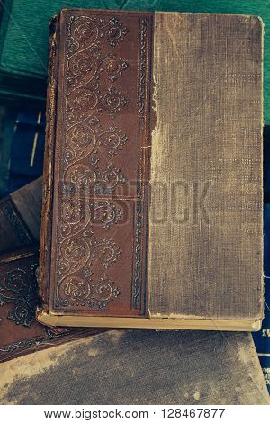 Ancient book with old beautiful ornate scratched hardcover
