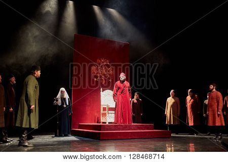 MOSCOW, RUSSIA - JAN 15, 2015: Throne with Tzar Boris and boyars on stage of Moscow theatre Et Cetera on the day of media preview of Boris Godunov directed by Peter Stein.