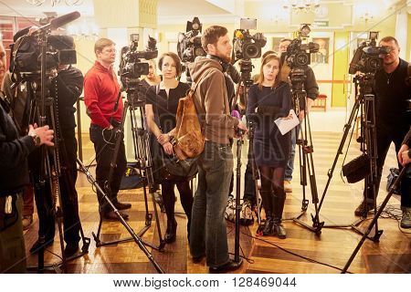 MOSCOW, RUSSIA - JAN 15, 2015: Journalists and cameramen stand in foyer before interviews after media preview of Boris Godunov directed by Peter Stein at Moscow theatre Et Cetera.