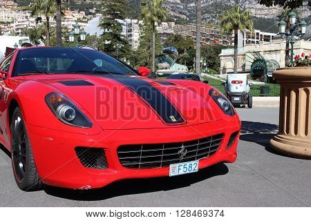 Monte-Carlo Monaco - March 9 2016: Red Ferrari 430 Scuderia Parked in Front of the Monte-Carlo Casino in Monaco