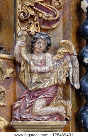 KOTARI, CROATIA - SEPTEMBER 16: Angel, main altar in the church of Saint Leonard of Noblac in Kotari, Croatia on September 16, 2015.