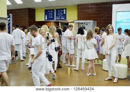 RUSSIA, MOSCOW - JUN 12, 2015: People in hall at entrances to grandstands of Olympiysky sports complex before Sensation Wicked Wonderland show begins.