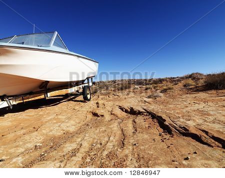 Landscape of motorboat sitting in the middle of the desert in rural Arizona, United States.