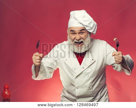Bearded Cook With Spoon And Fork