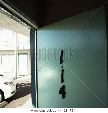 Motel room door on first floor that has been left open.