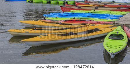 Resting kayaks on calm waters in spring