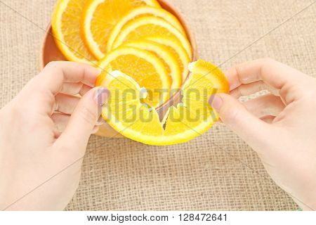 fruit in a wooden plate exposed to excellent illustration apelsynna background of burlap spinning the main arm in termination of orange ready for consumption