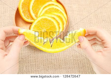 fruit in a wooden plate exposed to excellent illustration of juicy ripe orange background of burlap spinning the main arm in termination of orange ready for consumption
