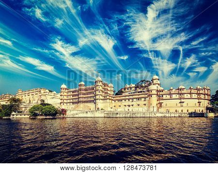 Vintage retro effect filtered hipster style image of City Palace view from the lake. Udaipur, Rajasthan, India