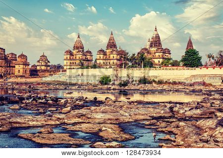 Vintage retro effect filtered hipster style image of tourist indian landmark - view of Royal cenotaphs of Orchha over Betwa river. Orchha, Madhya Pradesh, India