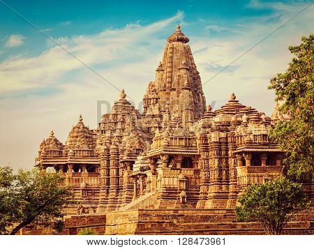 Vintage retro effect filtered hipster style image of famous Indian tourist landmark - Kandariya Mahadev Temple, Khajuraho, India. Unesco World Heritage Site