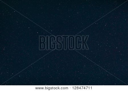 Background image of stars at night on the clear sky