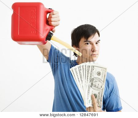 Asian young man holding gas can pouring gasoline onto money.