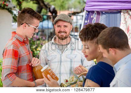 Handsome Man With Honey Vendor At Famers Market