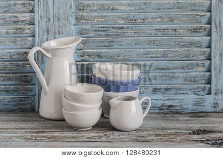 Vintage crockery on a light wooden background. Kitchen still life in rustic style
