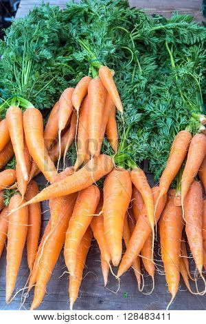 Carrots with leaves for sale at a market