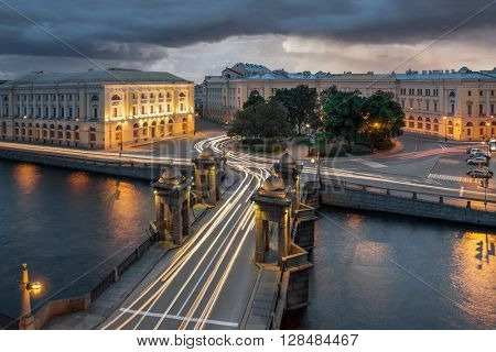 Roads and bridge of Lomonosov over the river Fontanka in St. Petersburg with traces of moving cars lights, long exposure shot.