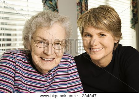 Portrait of an adult woman and senior woman smiling at the camera. Horizontal shot.