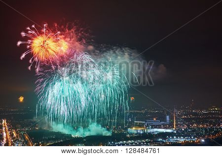 Colourful firework  in night sky over city.