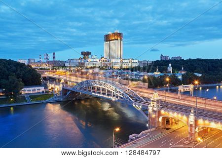 Evening view at the Russian Academy of Sciences and Novoandreevsky Bridge over the Moscow River.