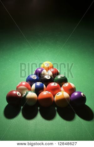 Racked pool balls on pool table. Vertical shot.