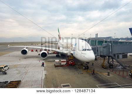 HONG KONG - MARCH 08, 2016: Emirates Airbus A380 docked in Hong Kong International Airport. Hong Kong International Airport is the main airport in Hong Kong