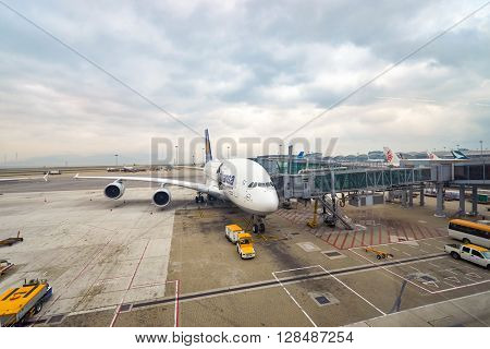 HONG KONG - MARCH 08, 2016: Lufthansa Airbus A380 docked in Hong Kong International Airport. Hong Kong International Airport is the main airport in Hong Kong