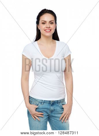advertisement, clothing and people concept - happy smiling young woman or teenage girl in white t-shirt