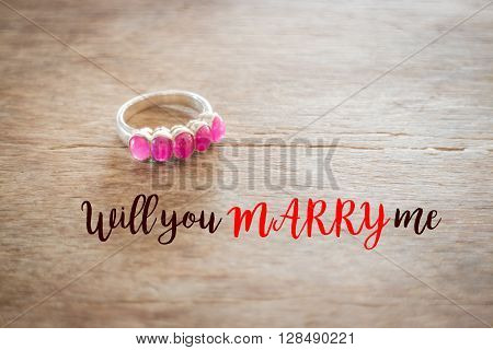 Beautiful classic ruby ring with love quote stock photo