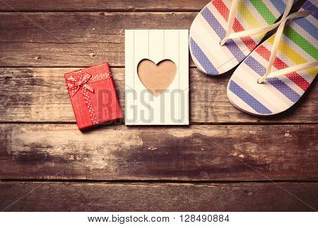 colorful sandals postcard and gift on the brown wooden background