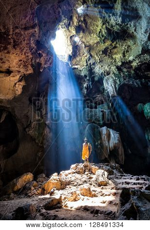 Amazing Buddhism with the ray of light in the cave Ratchaburi Province Thailand