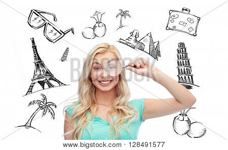 people, tourism, vacation and summer holidays concept - happy smiling young woman or teenage girl looking through magnifying glass over touristic doodles
