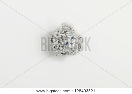disastrously aluminium foil ball isolated on white background