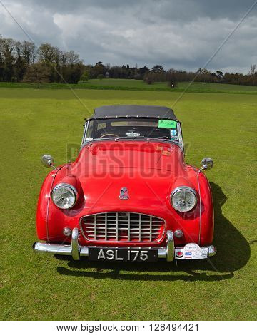 Saffron Walden, Essex, England - April 24, 2016: Classic Red Triumph TR3 sports car at Audley End.